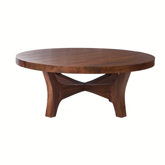 Our Garrick Coffee Table in a rich honey-colored finish is notable for its thick round wooden top that shows off the grain of the reclaimed teak.