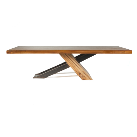 Our Emery Dining Table displays a cross-section of reclaimed teak so you can see the beautiful grains; it's supported by intersecting pieces of iron and teak.